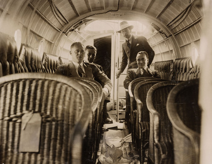 Four men in the passenger cabin of a Supermarine 'Swan' flying-boat, c 1924.