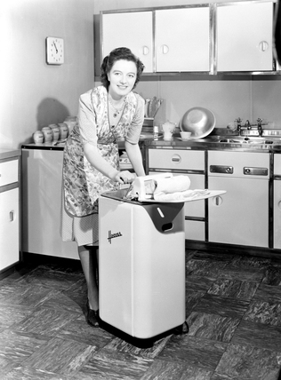 Woman Operating A Hoover Washing Machine And Wringer C