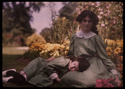 Two girls together in a garden, 1908.