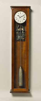 Electric master clock of the half minute impulse type in mahogany case, c 1931.