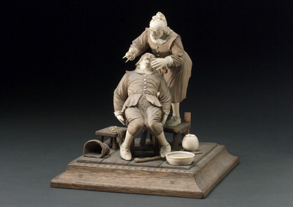 Wood and ivory figure group depicting a tooth extraction, 17th century?