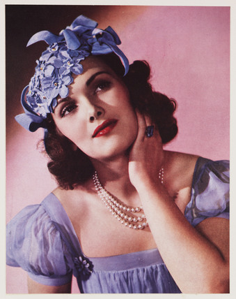 Woman modelling a hat, c 1940s.