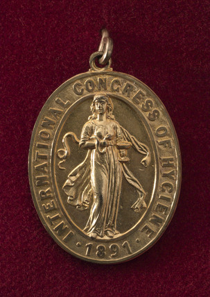 Oval badge issued by the International Congress of Hygiene, 1891.