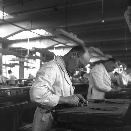 A Clicker At Work Cutting Out Leather Soles At A Shoe Factory 1950