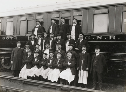 Railway workers beside a carriage, South Yorkshire, c 1916.