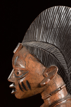 Detail from a carved wooden divination bowl, Nigeria, 1880-1920.