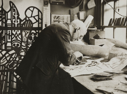 Workman cutting glass for a stained glass window, 17 April 1934.