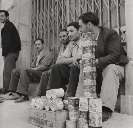 British Army supplies of corned beef being sold in Greece, 18 June 1946.