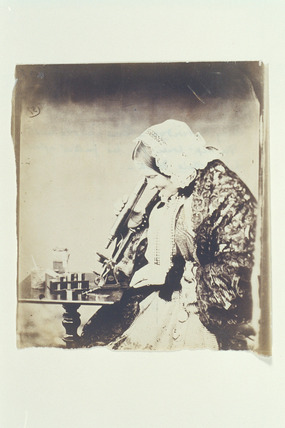 Lucy Lutwidge with microscope, c 1858.