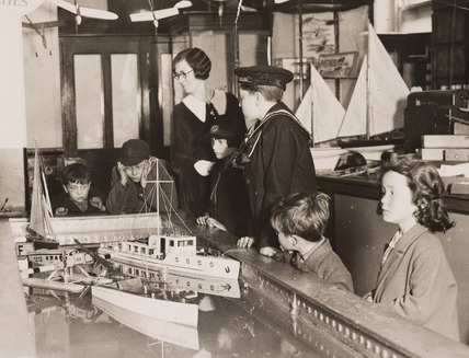 Boats on a miniature lake, Gamages Department Store, London, 1920s.