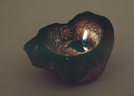 Primitive lamp, a stone used as a floating wick holder, 1801-1900.