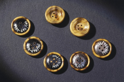 Celluloid-covered steel buttons, early 20th century.