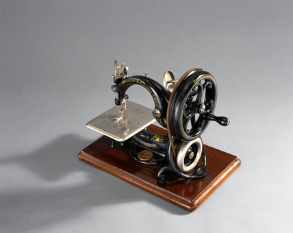 Willcox and Gibbs chain-stitch sewing machine, c 1890.