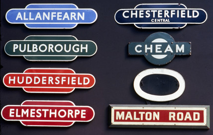 A selection of enamel station signs, early 20th century.