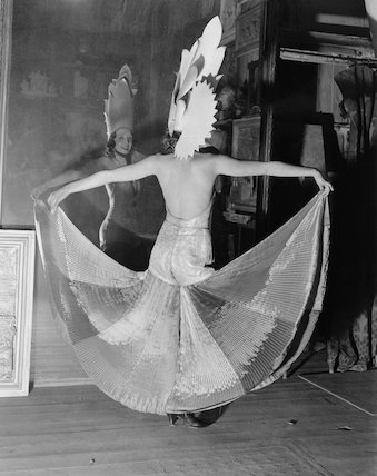 A female art student in her costume in front of a mirror before the Chelsea Arts Ball, London, 27 October 1931.