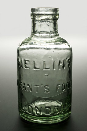 Green clear glass bottle for Mellins Infants Food, British, no stopper.
