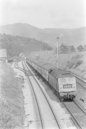 A diesel locomotive pulling a passenger train,A1969.70/Box 5/Neg 1241/30
