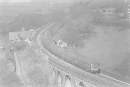 A diesel locomotive pulling a passenger train, view from above,A1969.70/Box 5/Neg 1255/31