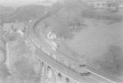 A diesel locomotive hauling a goods train, view from above,A1969.70/Box 5/Neg 1255/32