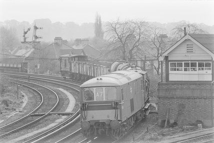 A third-rail electric locomotive hauling a goods train, passing a junction,A1969.70/Box 5/Neg 1258/27