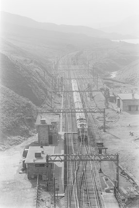 An electric locomotive pulling a passenger train, view from above.. ,A1969.70/Box 5/Neg 1276/16