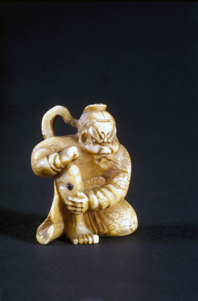 Netsuke showing a man applying moxa, Japanese.