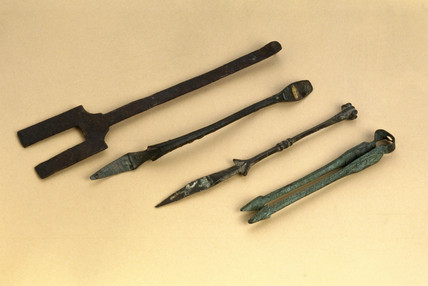 Bronze forceps, spoon, elevator and cautery, 200 BC-1600 AD.