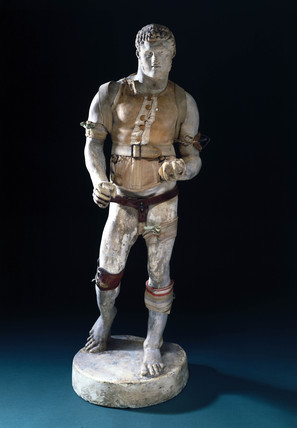 Male figure with trus, c 1860-1910.