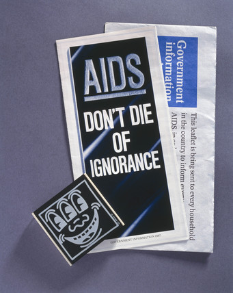 Government AIDS awarenes leaflets and box of condoms, 1987.