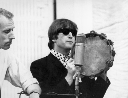 Beatle John Lennon with record producer George Martin, 2 October 1964.