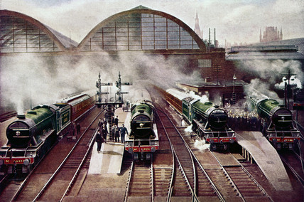 Four locomotives at King's Cross station, London, c 1930.