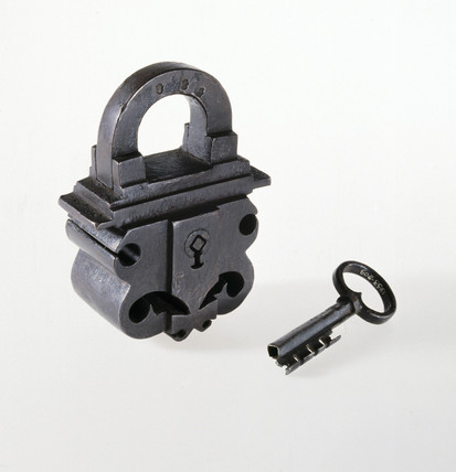 Heavy, black wrought-iron padlock with hollow 4-ward key, 1600-1800.