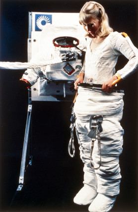 Donning a Space Shuttle spacesuit, 1983.
