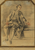 Young man, seated, holding a riding crop