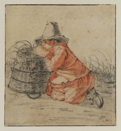 Boy resting against a basket