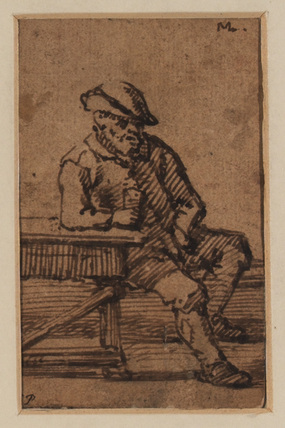 Man seated at a table with a glass of wine