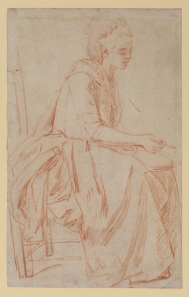 Young woman with a bowl and spoon