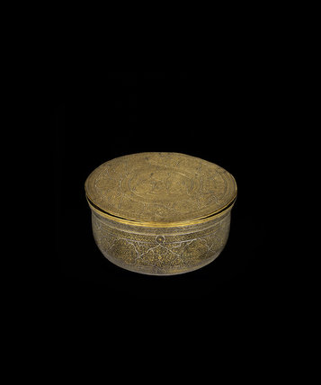 Bowl-shaped box with cover of engraved brass inlaid with silver