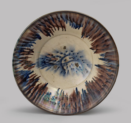 Bowl decorated in blue and manganese (front view)