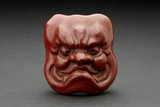 Netsuke - Red lacquer mask of Ō-Beshimi