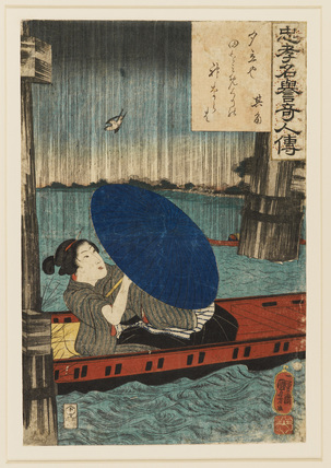 A woman in boat sheltering from the rain under an umbrella