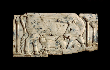 Decorative plaque with relief of a cow and calf among papyrus plants