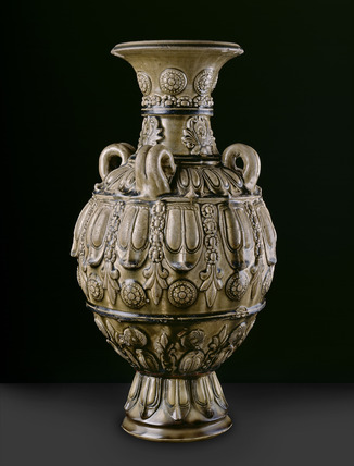 Greenware jar with moulded decoration