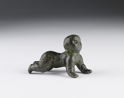 Figurine of a crawling baby