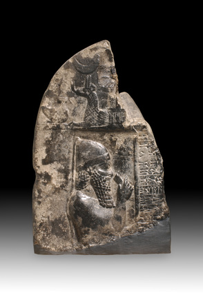 Babylonian 'kudurru' (boundary stone) fragment depicting king Ashurnadinshumi