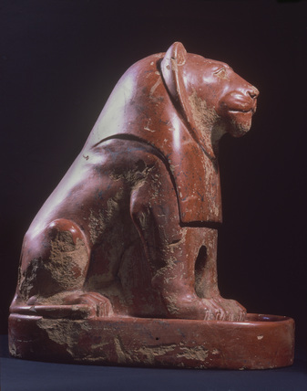 Seated lion on a plinth, polished red ware