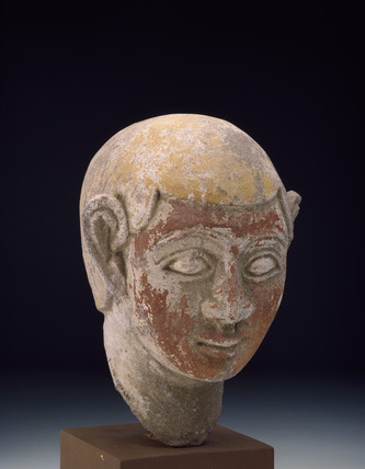 Painted sandstone head of a ba-statue