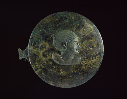 Bronze mirror case, in two parts. Top, outer face: applique Hellenistic female bust