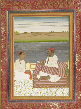 Dark complexioned man seated on a terrace, with an attendant or pupil