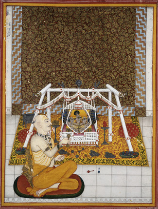 Seated priest officiating before deities (Brijrayji) on a swing